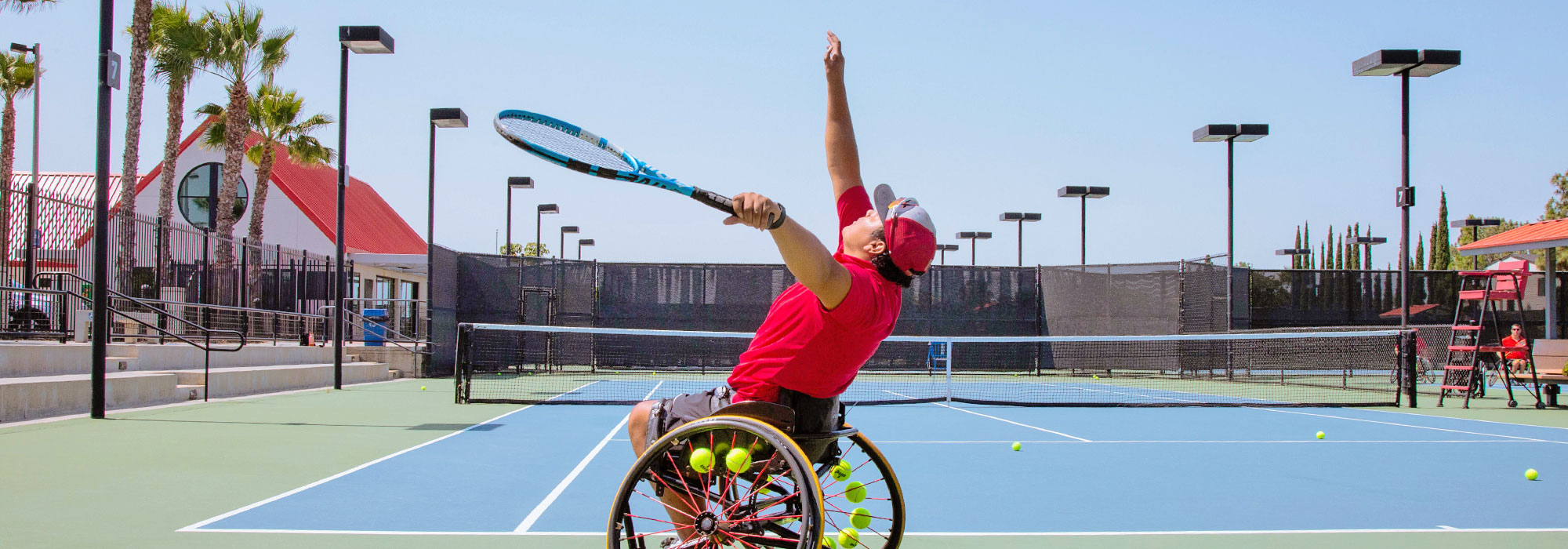 Adapted Athletics - Serve practice on Tennis Court in wheelchair