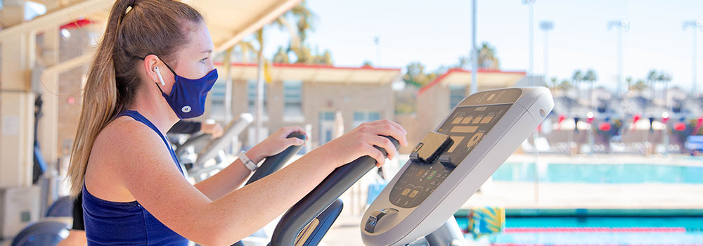 Woman on elliptical machine at Aquaplex