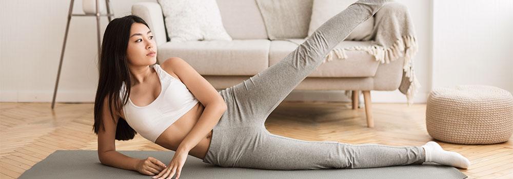 Woman doing leg lifts at home