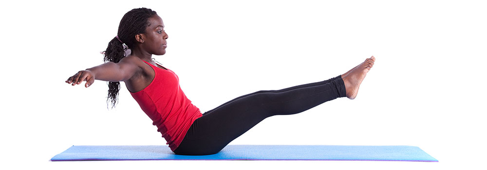 Woman doing ab workout on the mat