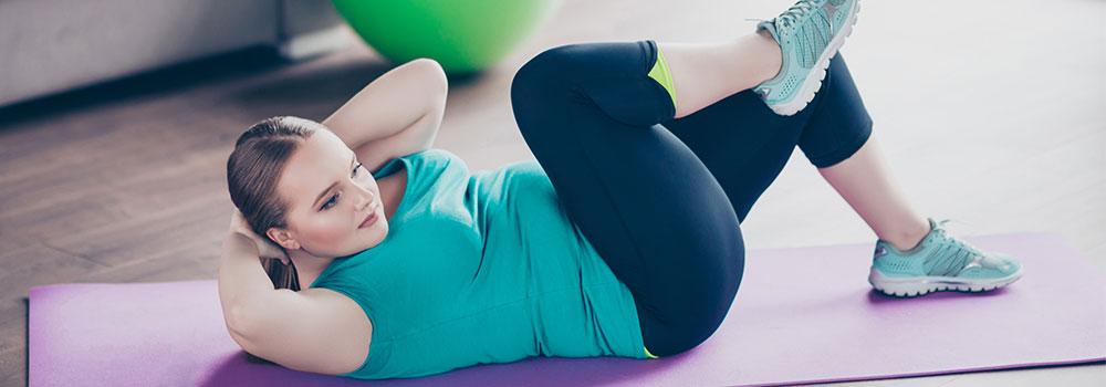 Woman following online fitness workout