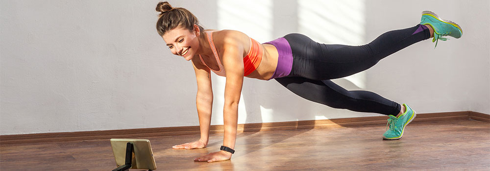Woman following online fitness instructions