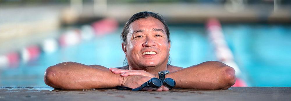 Man smiling in Aquaplex Pool