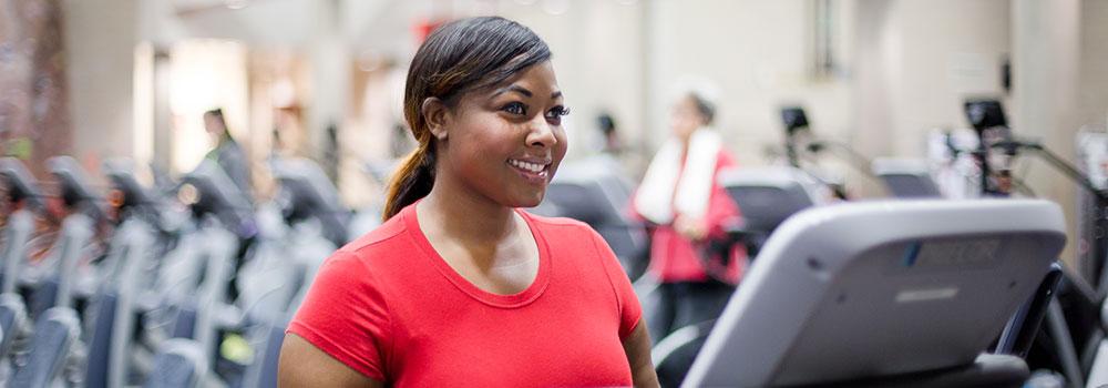 Woman on elliptical machine in cardio room at ARC