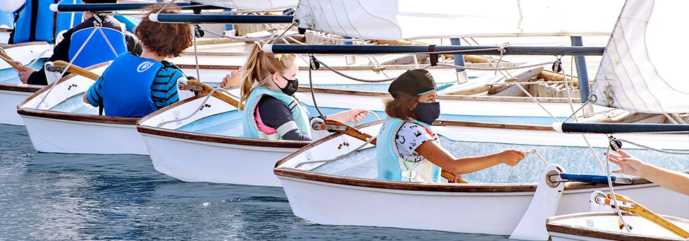 Kids taking watersports sailing class